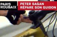 Sagan fixing his handlebars
